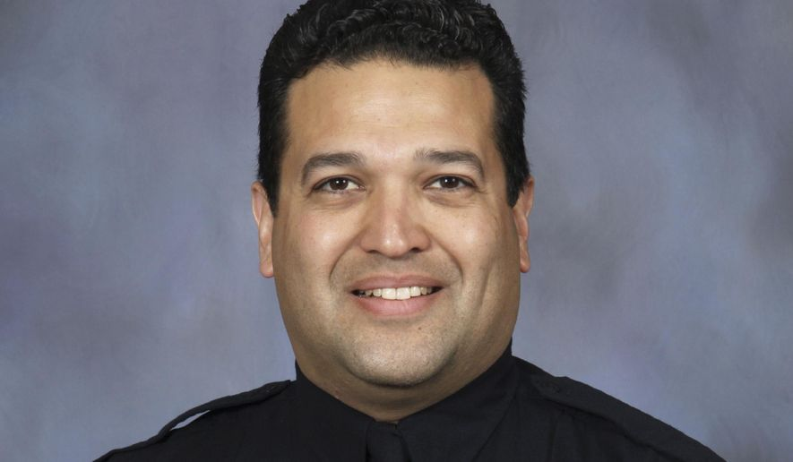 """FILE - This photo provided by the Lincoln, Neb., police department, shows Lincoln police officer Luis """"Mario"""" Herrera. Authorities said Herrera, who was shot while attempting to arrest a 17-year-old on an assault charge, died Monday, Sept. 7, 2020, after a nearly two-week battle to save his life.  (Lincoln Police Department via AP, File)"""