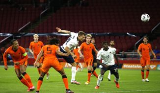 Italy's Nicolo Barella, center scores his side's first goal during the UEFA Nations League soccer match between The Netherlands and Italy at the Johan Cruijff ArenA in Amsterdam, Netherlands, Monday, Sept. 7, 2020. (AP Photo/Peter Dejong)