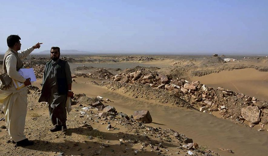 Local officials visit the gold and copper mine site, in Reko Diq district in southwestern Pakistan's Baluchistan province March 18, 2017. Pakistan is seeking the reversal of a $5.8 billion penalty imposed by an international tribunal for denying a mining lease to an Australian company, saying that paying the fine will hinder its ability to cope with the coronavirus pandemic. The Reko Diq district is famed for its mineral wealth, including gold and copper. (AP Photo/Naseem James)