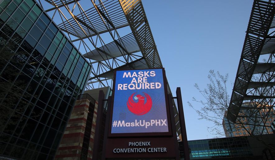 This Sept. 3, 2020 photo shows the Phoenix Convention Center in Phoenix.  The facility has offered some relief to people living on the street during record-breaking temperatures and the coronavirus pandemic. (AP Photo/Cheyanne Mumphrey)