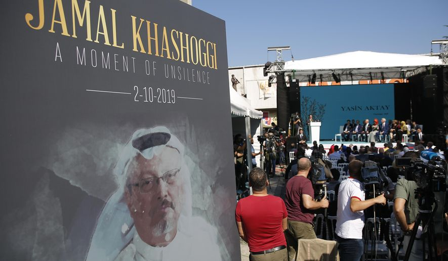 In this Oct. 2, 2019, file photo, a picture of slain Saudi journalist Jamal Kashoggi is displayed during a ceremony near the Saudi Arabia consulate in Istanbul, marking the one-year anniversary of his death. (AP Photo/Lefteris Pitarakis, File)