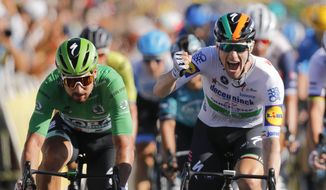 Ireland's Sam Bennett, right, celebrates as he crosses the finish line ahead of third place Slovakia's Peter Sagan, left, during stage 10 of the Tour de France cycling race over 168.5 kilometers (104.7 miles) from Ile d'Oleron to Ile de Re, France, Tuesday, Sept. 8, 2020. (AP Photo/Christophe Ena, Pool)