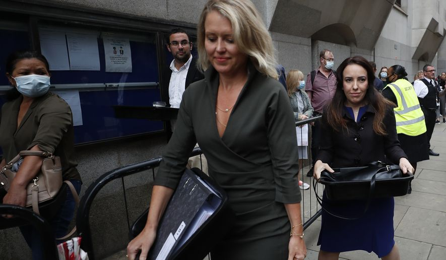 Julian Assange's lawyer Jennifer Robinson, center, and Assange's partner Stella Moris, right arrive to the Central Criminal Court Old Bailey in London, Tuesday, Sept. 8, 2020. (AP Photo/Frank Augstein)