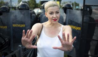 In this Sunday, Aug. 30, 2020, file photo, Maria Kolesnikova, one of Belarus' opposition leaders, gestures during a rally in Minsk, Belarus. Maria Kolesnikova, a leading opposition activist and several other members of an opposition council in Belarus went missing Monday, Sept. 7, 2020, and their colleagues feared they were detained as part of the authorities' efforts to squelch nearly a month of protests against the reelection of the country's authoritarian leader. (Tut.By via AP, File)