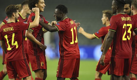 Belgium's Jeremy Doku, center, is congratulated by teammates after scoring his sides fifth goal during the UEFA Nations League soccer match between Belgium and Iceland, at the King Baudouin stadium in Brussels, Tuesday, Sept. 8, 2020. (AP Photo/Francisco Seco)