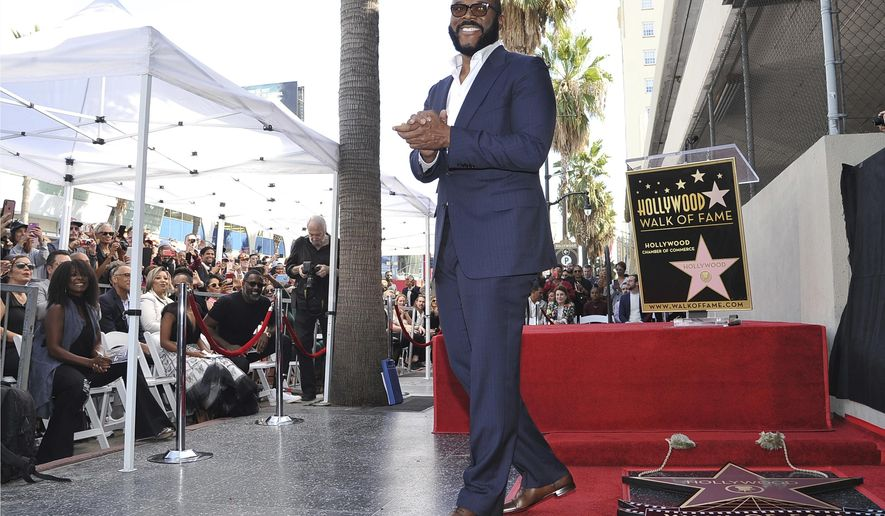 "FILE - Filmmaker/actor Tyler Perry, known for the ""Madea"" films, appears during a ceremony honoring him with with a star on the Hollywood Walk of Fame on Oct. 1, 2019, in Los Angeles. Perry turns 51 on Sept. 14. (Photo by Richard Shotwell/Invision/AP, File)"