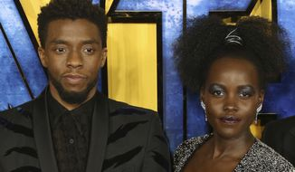 """FILE - Chadwick Boseman, left, and Lupita Nyong'o arrive at the premiere of their film """"Black Panther"""" on Feb. 8, 2018, in London. Nyong'o has written a long and stirring tribute to Boseman, her late cast mate, calling him a man whose power will """"reverberate for generations"""" in a message posted to her social media accounts 11 days after Boseman's death from colon cancer at age 43. (Photo by Joel C Ryan/Invision/AP, file)"""