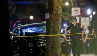 Police work the scene where an 8-year-old girl was killed and two adults were gunned down when someone shot into a car near the intersection of 47th street and Union Avenue during the Labor Day weekend Monday, Sept. 7, 2020, in Chicago. (Armando L. Sanchez/Chicago Tribune via AP)