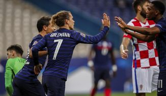 France's Antoine Griezmann celebrates after scoring his first goal during a UEFA Nations League soccer match against Croatia at the Stade de France stadium in Saint-Denis, north of Paris, France, Tuesday, Sept. 8, 2020. (AP Photo/Francois Mori)