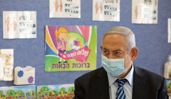 Israeli Prime Minister Benjamin Netanyahu attends a ceremony to mark the opening of the school year, at the Netaim School in the West Bank settlement of Mevo Horon, Tuesday, Sept. 1, 2020. (Marc Israel Sellem/Pool via AP)