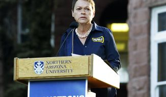 FILE - In this Oct. 13, 2015, file photo, Northern Arizona University President Rita Cheng speaks on the NAU campus in Flagstaff, Ariz., to honor the victim and wounded of a deadly shooting on campus. Cheng announced Tuesday, Sept. 8, 2020, she will not seek an extension of her contract, which expires in 2021. (Taylor Mahoney/Arizona Daily Sun via AP, File)