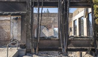 A commercial building that was destroyed by wildfire is shown Tuesday, Sept. 8, 2020, in Malden, Wash. High winds kicked up wildfires across the Pacific Northwest on Monday and Tuesday, burning hundreds of thousands of acres and mostly destroying the small town of Malden in eastern Washington state. (AP Photo/Jed Conklin)
