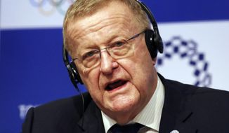In this Dec. 5, 2018, file photo, John Coates, the leader of the IOC's coordination commission for the Tokyo Olympics, speaks during a press conference in Tokyo. The International Olympic Committee and Japanese organizers are trying to remove public doubts that the postponed Tokyo Olympics will take place next year despite the COVID-19 pandemic. Tokyo organizing committee CEO Toshiro Muto said last week that the games could go ahead without a vaccine. This week John Coates, the IOC member from Australia who oversees the Tokyo Olympics, said the games would happen despite the pandemic.(AP Photo/Koji Sasahara, File)  **FILE**