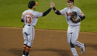 Baltimore Orioles shortstop Andrew Velazquez (13) celebrates with Baltimore Orioles left fielder Ryan Mountcastle (6) after the Orioles victory over the New York Mets in a baseball game, Tuesday, Sept. 8, 2020, in New York. (AP Photo/Kathy Willens)