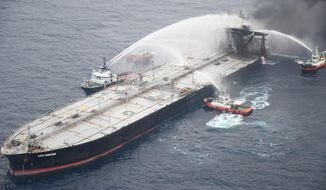 This photo released by Sri Lankan Air Force shows ships fighting fire on the MT New Diamond, about 30 nautical miles off the coast of Sri Lanka, Tuesday, Sept. 8, 2020. Ships and aircraft from Sri Lanka and India intensified efforts to extinguish a new fire on an oil tanker off Sri Lanka's coast on Tuesday, two days after the previous three-day blaze was doused, the navy said. (Sri Lankan Air Force via AP)