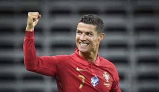 Portugals Ronaldo celebrates after scoring against Sweden during their UEFA Nations League Group stage soccer match at Friends Arena in Stockholm, Sweden, Tuesday Sept. 8, 2020. (Janerik Henriksson / TT via AP)