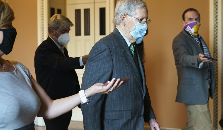Senate Majority Leader Mitch McConnell of Ky., center, walks to his office from the Senate floor, Tuesday, Sept. 8, 2020, on Capitol Hill in Washington. (AP Photo/Jacquelyn Martin)
