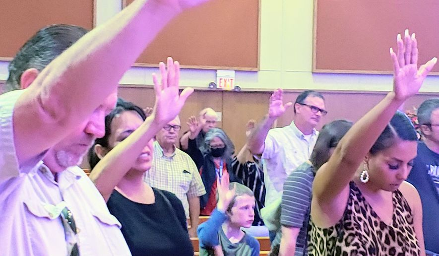 """Attendees pray at Sept. 5, 2020, meeting on """"sanctuary cities for the unborn"""" at the Church of the Blessed International in Lubbock, Texas. (Photo courtesy of Mark Lee Dickson)"""