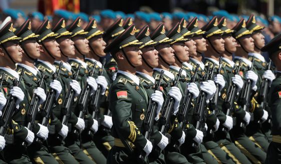 "China is building up its People's Liberation Army and stepping up provocations and military coercion in Asia, including against pro-democracy protesters in Hong Kong. ""Gray zone"" warfare below the level of armed clashes is seen as as part of Beijing's strategy to increase its power and influence throughout the region. (Associated Press/File)"