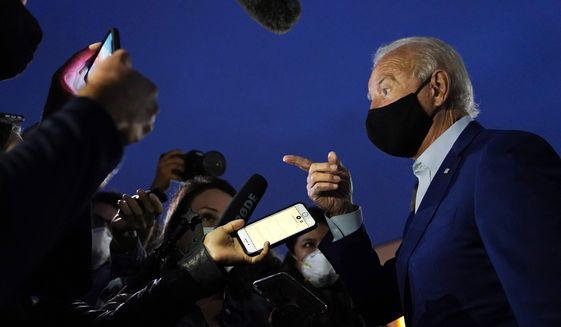 Democratic presidential candidate and former Vice President Joe Biden speaks with reporters before boarding a plane at Detroit Metropolitan Wayne County Airport in Detroit, Wednesday, Sept. 9, 2020. Biden is returning to his home in Delaware after attending campaign events in Michigan. (AP Photo/Patrick Semansky)