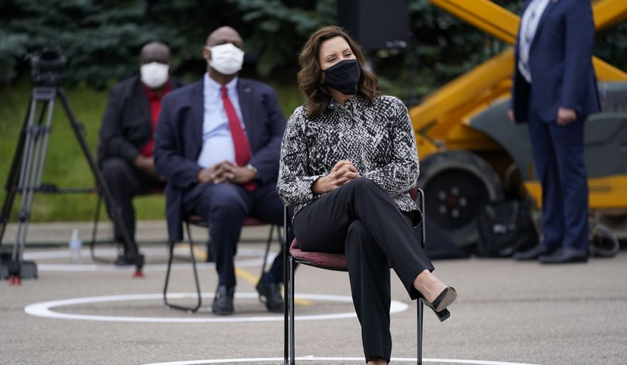 Michigan Gov. Gretchen Whitmer listens as Democratic presidential candidate former Vice President Joe Biden speaks at a campaign event on manufacturing and buying American-made products at UAW Region 1 headquarters in Warren, Mich., Wednesday, Sept. 9, 2020. (AP Photo/Patrick Semansky)  **FILE**