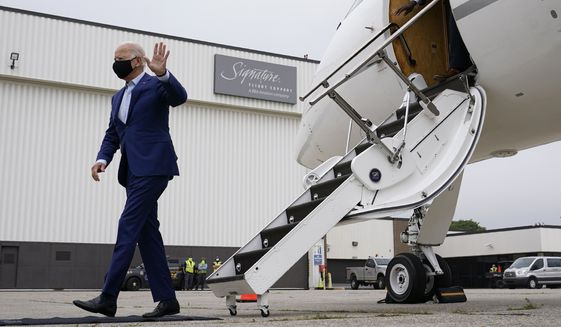 Democratic presidential candidate former Vice President Joe Biden waves as he steps off a plane at Detroit Metropolitan Wayne County Airport in Detroit, Wednesday, Sept. 9, 2020. Biden is attending campaign events in Michigan. (AP Photo/Patrick Semansky)