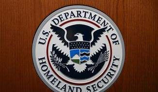 In this June 28, 2019, file photo the Department of Homeland Security (DHS) seal is seen during a news conference in Washington. (AP Photo/Carolyn Kaster, File)  **FILE**