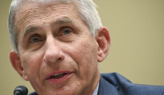 In this July, 31, 2020 file photo, Dr. Anthony Fauci, director of the National Institute for Allergy and Infectious Diseases, testifies before a House Select Subcommittee hearing on the coronavirus on Capitol Hill in Washington. (Erin Scott/Pool via AP, File)   **FILE**