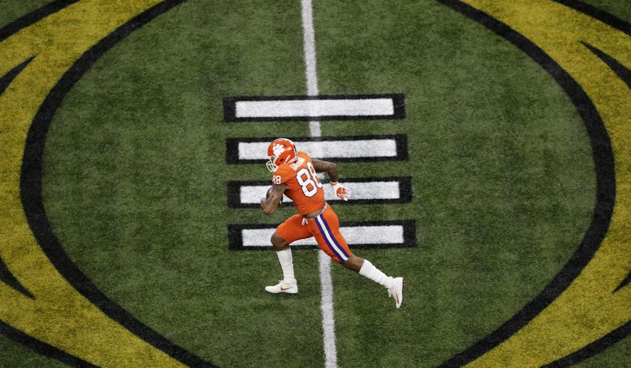 FILE - Clemson tight end Braden Galloway runs against LSU during the first half of the NCAA College Football Playoff national championship game Monday, Jan. 13, 2020, in New Orleans. Galloway is seeing shorter lines at fast-food restaurants and fewer people around campus after Clemson started the fall semester with online-only undergraduate classes amid the coronavirus pandemic. (AP Photo/Eric Gay, File)