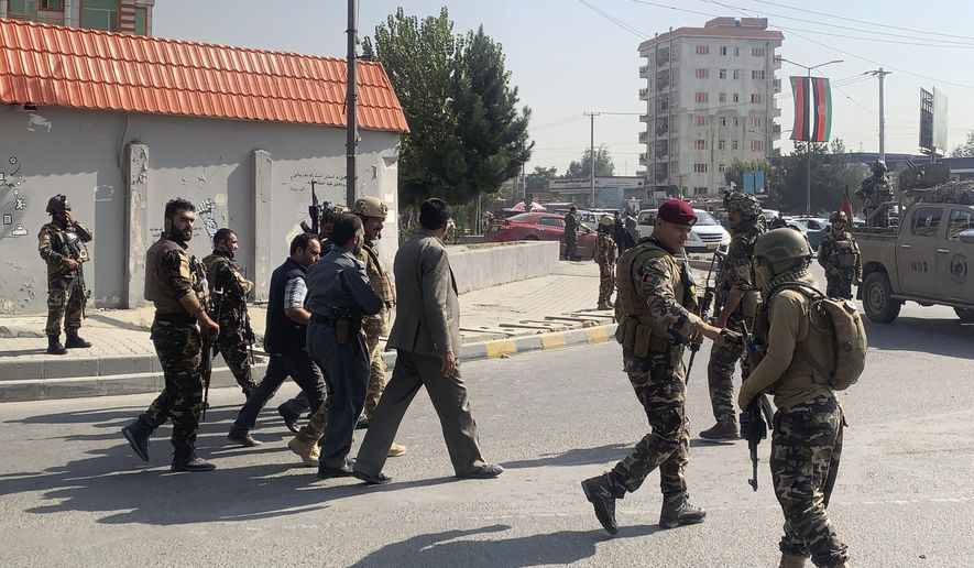 Afghan security personnel arrive at the site of an explosion in Kabul, Afghanistan, Wednesday, Sept. 9, 2020. Spokesman for Afghanistan's Vice President Amrulleh Saleh said a bomb in the Afghan capital that killed a few civilians Wednesday was a failed assassination attempt against Saleh. (AP Photo/Rahmat Gul)