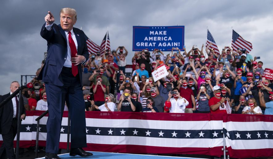 President Donald Trump arrives to speak at a campaign rally at Smith Reynolds Airport, Tuesday, Sept. 8, 2020, in Winston-Salem, N.C. (AP Photo/Evan Vucci)