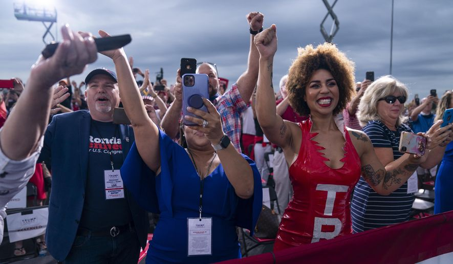 Supporters of President Donald Trump cheer as he arrives to speak at a campaign rally at Smith Reynolds Airport, Tuesday, Sept. 8, 2020, in Winston-Salem, N.C. (AP Photo/Evan Vucci)