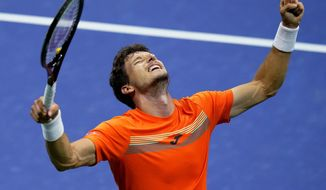 Pablo Carreno Busta, of Spain, reacts after defeating Denis Shapovalov, of Canada, during the quarterfinal round of the US Open tennis championships, early Wednesday, Sept. 9, 2020, in New York. (AP Photo/Frank Franklin II)