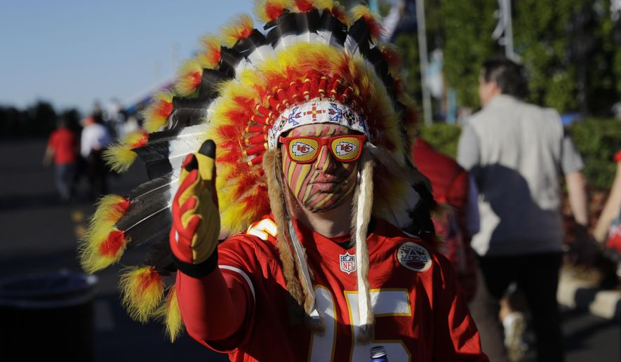 In this Feb. 2, 2020 file photo, a Kansas City Chiefs fan walks outside the stadium before the NFL Super Bowl 54 football game between the San Francisco 49ers and Kansas City Chiefs in Miami Gardens, Fla. The Kansas City Chiefs fans who file into Arrowhead stadium Thursday, Sept. 10, 2020 for a masked and socially distanced start to the current season won't be wearing headdresses or face paint amid a nationwide push for racial justice following the death of George Floyd in Minneapolis. (AP Photo/Seth Wenig) File)