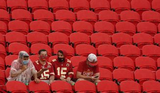 Fans watch the Kansas City Chiefs during  NFL football training camp Saturday, Aug. 29, 2020, at Arrowhead Stadium in Kansas City, Mo. The Chiefs opened the stadium to 5,000 season ticket holders to watch practice as the team plans to open the regular season with a reduced capacity of approximately 22 percent of normal attendance. (AP Photo/Charlie Riedel)
