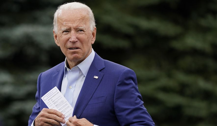 Democratic presidential candidate former Vice President Joe Biden places a note card in his jacket pocket as he speaks at a campaign event on manufacturing and buying American-made products at UAW Region 1 headquarters in Warren, Mich., Wednesday, Sept. 9, 2020. (AP Photo/Patrick Semansky)
