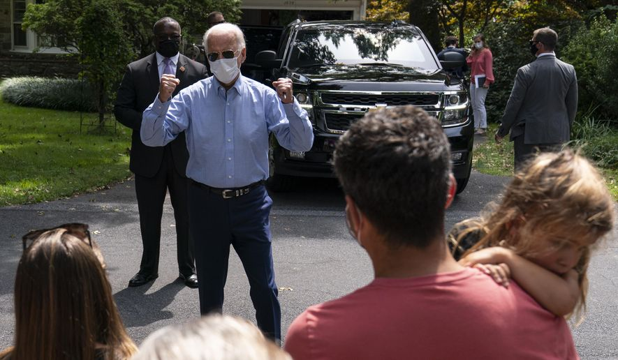 Democratic presidential candidate former Vice President Joe Biden greets people gathered as he leaves a backyard meeting in Lancaster, Pa., Monday, Sept. 7, 2020. (AP Photo/Carolyn Kaster)