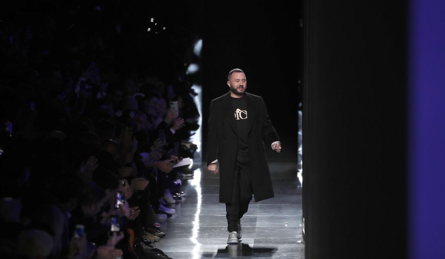 FILE -- In this Jan. 17, 2020 file photo, designer Kim Jones accepts applause after the Dior Homme Mens Fall/Winter 2020-2021 fashion collection presented in Paris. Rome fashion house Fendi announced Wednesday, Sept. 9, 2020 that Kim Jones is taking over from the late Karl Lagerfeld as creative director of haute couture, ready-to-wear and fur collections. Jones will take on the Fendi duties while staying on as artistic director of Dior Homme. (AP Photo/Francois Mori)