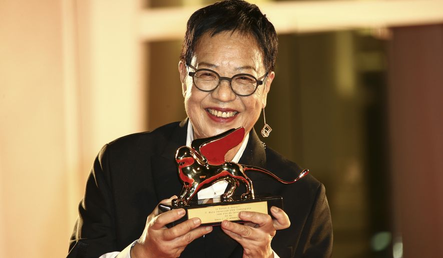 Director Ann Hui holds her Golden Lion award for Lifetime Achievement during the 77th edition of the Venice Film Festival in Venice, Italy, Tuesday, Sept. 8, 2020. (Photo by Joel C Ryan/Invision/AP)