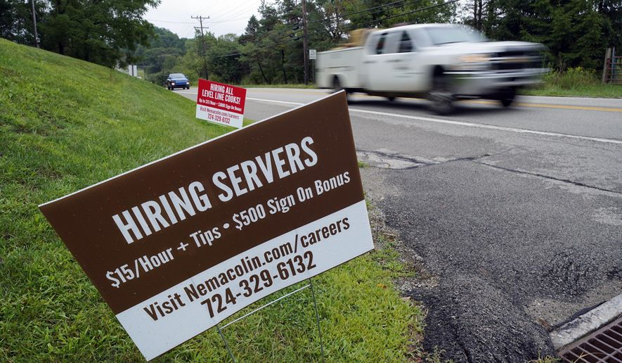 In this Wednesday, Sept. 2, 2020, file photo help wanted signs for servers and cooks at Nemacolin Woodlands Resort and Spa are displayed along route 40 at the entrance to the resort in Farmington, Pa. U.S. employers advertised more jobs but hired fewer workers in July, sending mixed signals about a job market in the wake of the coronavirus outbreak. The Labor Department said Wednesday, Sept. 9, 2020, that the number of U.S. job postings on the last day of July rose to 6.6 million from 6 million at the end of June. (AP Photo/Gene J. Puskar, File)