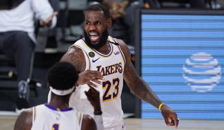 Los Angeles Lakers' LeBron James (23) questions a call during the second half of an NBA conference semifinal playoff basketball game against the Houston Rockets Tuesday, Sept. 8, 2020, in Lake Buena Vista, Fla. (AP Photo/Mark J. Terrill)