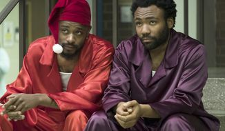 """This image released by FX shows Lakeith Stanfield, left, and Donald Glover in a scene from """"Atlanta."""" The FX comedy created by and starring Glover will begin its pandemic-delayed production in the first half of 2021, FX Networks Chairman John Landgraf said Wednesday, Sept. 9, 2020. (Guy D'Alema/FX via AP)"""