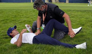 FILE - Brooks Koepka gets treated for an injury on the 12th hole during the second round of the PGA Championship golf tournament at TPC Harding Park Friday, Aug. 7, 2020, in San Francisco. Two-time champion Brooks Koepka withdrew from the U.S. Open on Wednesday, Sept. 9, because of lingering pain in his left knee that has troubled him most of the year. (AP Photo/Jeff Chiu, File)