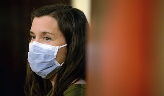 FILE - In this Wednesday, April 8, 2020, file photo, Salt Lake City Mayor Erin Mendenhall wears a face mask as she attends the daily COVID-19 media briefing at the Capitol in Salt Lake City. A police department vowed Tuesday, Sept. 8, 2020, to cooperate with multiple investigations of the shooting of a 13-year-old autistic boy by officers in the Salt Lake City area. Mendenhall said in a statement late Sunday, Sept. 6 that the shooting was a tragedy and called for a swift and transparent investigation. (Francisco Kjolseth/The Salt Lake Tribune via AP, Pool, File)