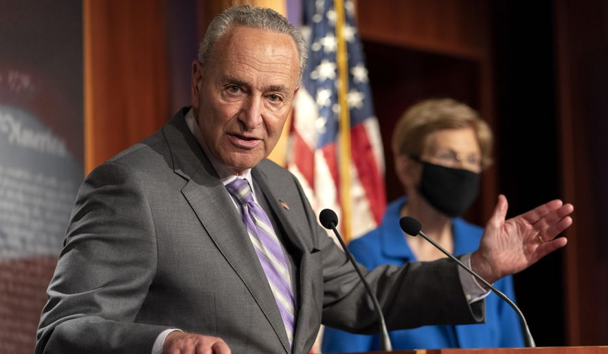 Senate Minority Leader Sen. Chuck Schumer of N.Y., left, with Sen. Elizabeth Warren, D-Mass., speaks during a news conference, Wednesday, Sept. 9, 2020, on Capitol Hill in Washington. (AP Photo/Jacquelyn Martin) **FILE**