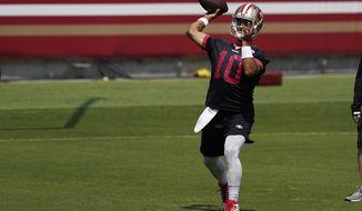 San Francisco 49ers quarterback Jimmy Garoppolo (10) passes during NFL football practice at Levi's Stadium in Santa Clara, Calif., Wednesday, Sept. 2, 2020. (AP Photo/Jeff Chiu, Pool)