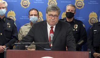 In this file photo, U.S. Attorney General William Barr speaks at a news conference, Thursday, Sept. 10, 2020, in Phoenix. (AP Photo/Bob Christie)  **FILE**