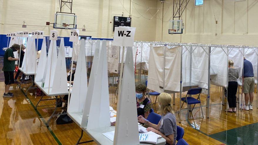 In this Tuesday, Sept. 8, 2020, photograph, voters cast their ballots in Exeter, N.H., in the state primary election. (Alexander LaCasse/SeacoastOnline.com/Portsmouth Herald via AP)  ** FILE **