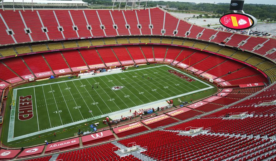 Team personnel walk on the field in Arrowhead Stadium before an NFL football game between the Kansas City Chiefs and the Houston Texans Thursday, Sept. 10, 2020, in Kansas City, Mo. (AP Photo/Jeff Roberson)
