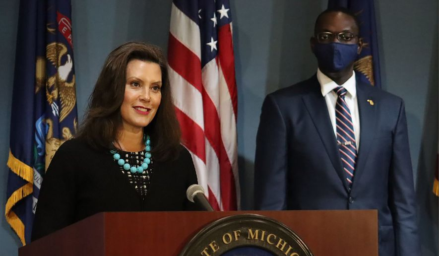 """In this photo provided by the Michigan Office of the Governor, Gov. Gretchen Whitmer addresses the state during a speech in Lansing, Mich., Thursday, Sept. 10, 2020. Whitmer on Thursday sharply criticized President Donald Trump following revelations that he had purposely downpla yed the deadly coronavirus, calling it """"devastating"""" news and Trump the """"biggest threat"""" to Americans.(Michigan Office of the Governor via AP)"""